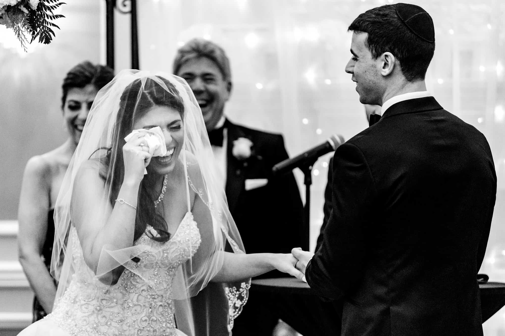 bride laughing and wiping away tears during her Arts Ballroom ceremony