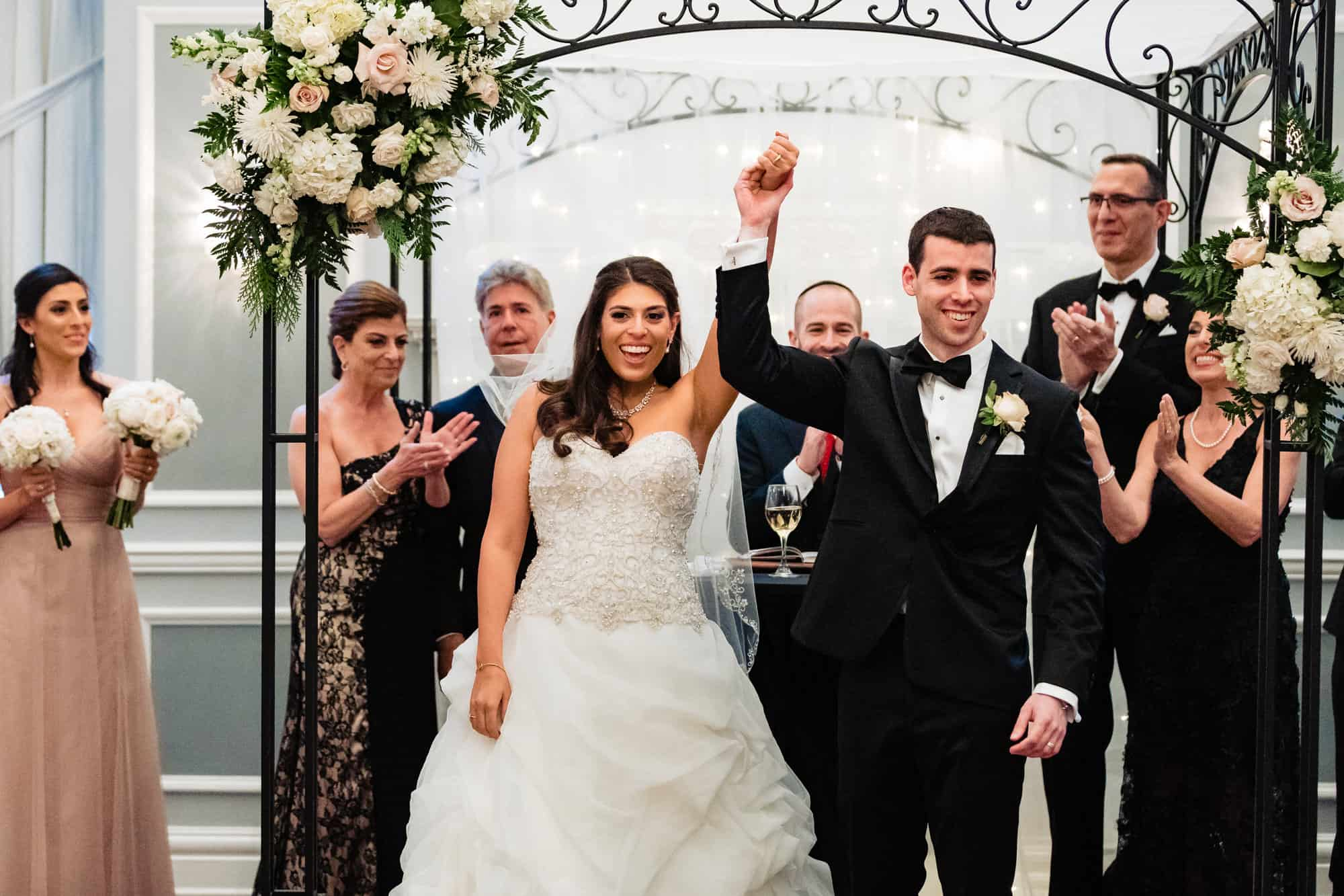 bride and groom celebrating after their Arts Ballroom ceremony