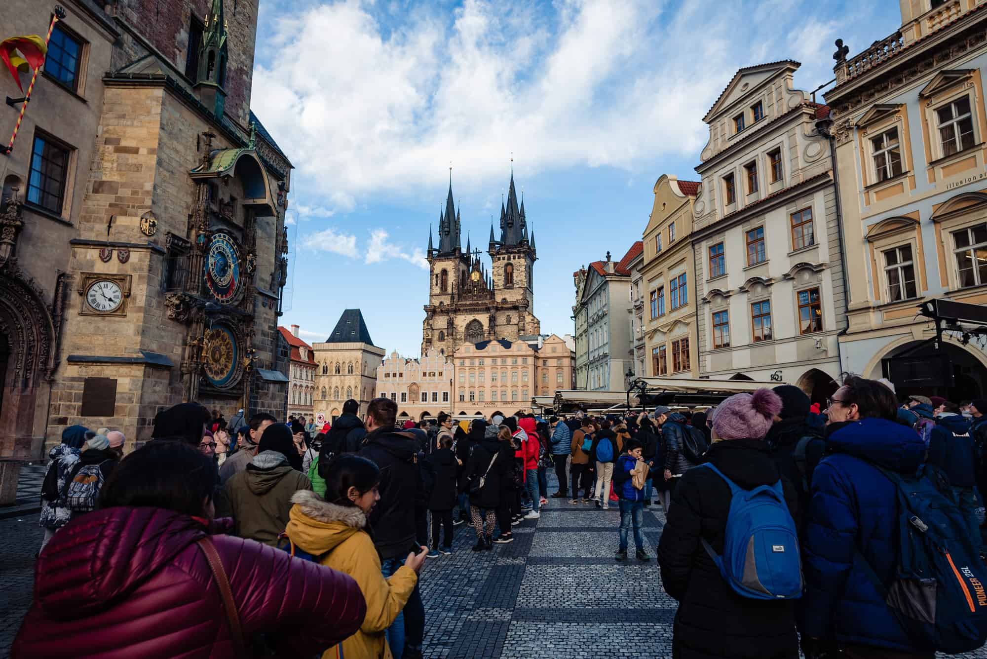Vacation photo shot through a crowd of people in the town square in Prague