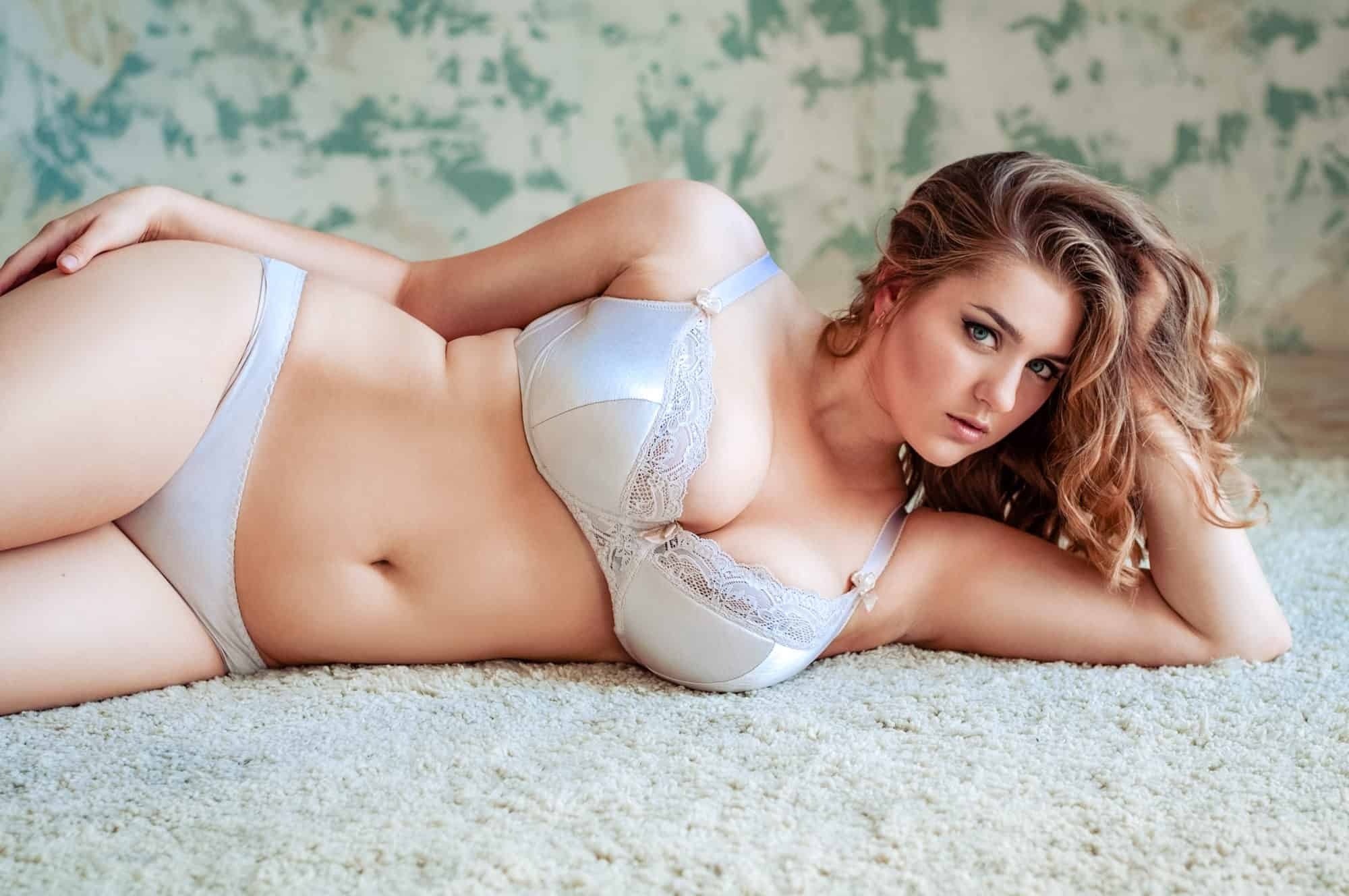 girl laying on side Curvy bridal boudoir
