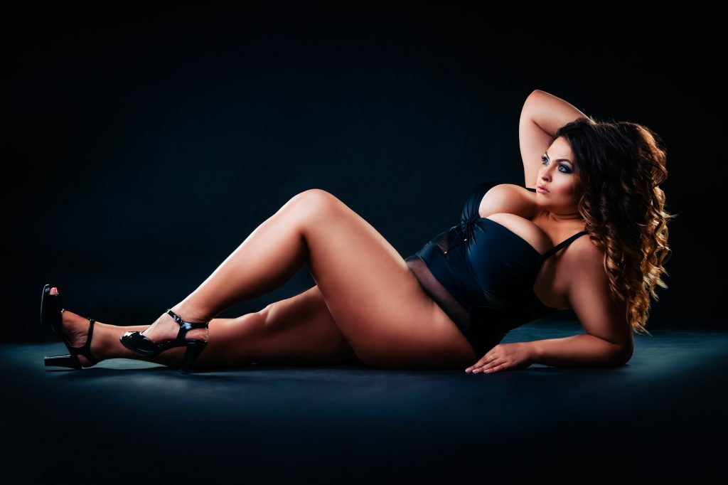 girl lounging on couch Curvy bridal boudoir